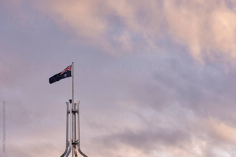 Australian Flag Flying Above Parliament House, Canberra by Adrian Young for Stocksy United