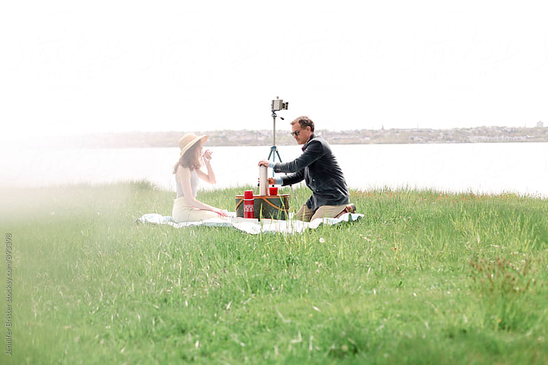 Couple having a picnic by Jennifer Brister for Stocksy United