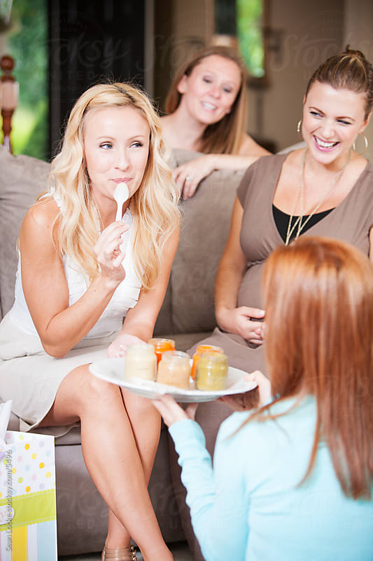 Baby Shower: Woman Tastes Baby Food as Part of Shower Game by Sean Locke for Stocksy United