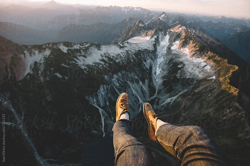 Dangling feet over the mountains by Sam Elkins for Stocksy United