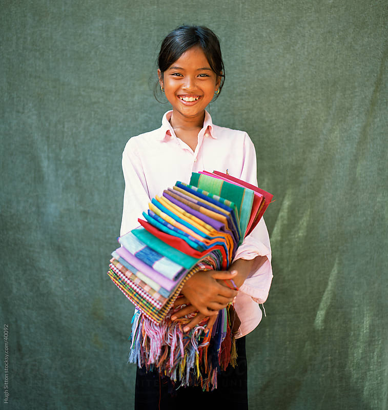 Smiling sarong seller. Angkor Wat. Cambodia. by Hugh Sitton for Stocksy United