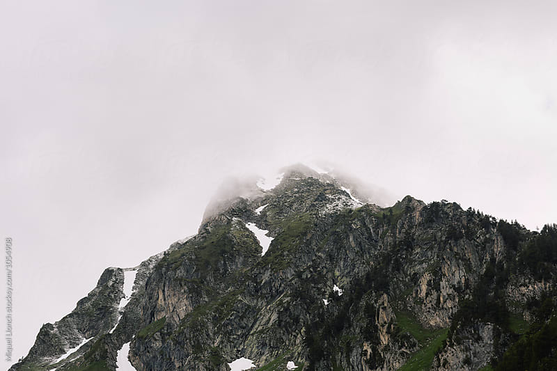Mountain landscape with stormy weather by Miquel Llonch for Stocksy United