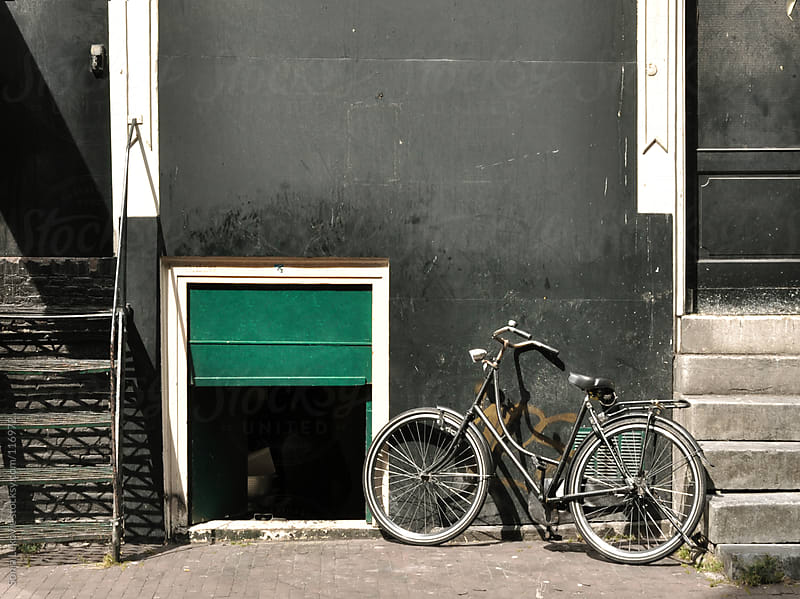 bicycle in the street by Sonja Lekovic for Stocksy United