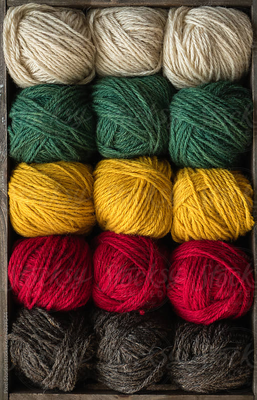 Colorful yarn balls in crate by Pixel Stories for Stocksy United