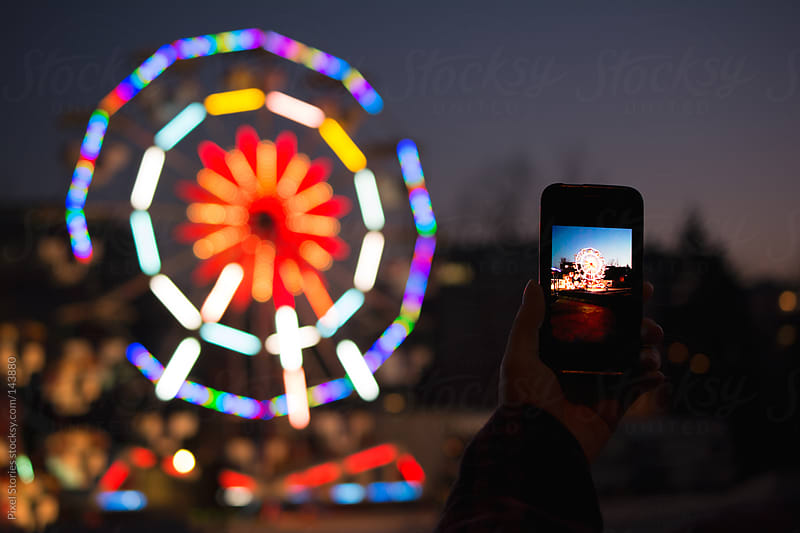 Taking photo at amusement park  by Pixel Stories for Stocksy United