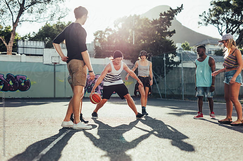 Group of young friends playing basketball match  by Jacob Lund for Stocksy United