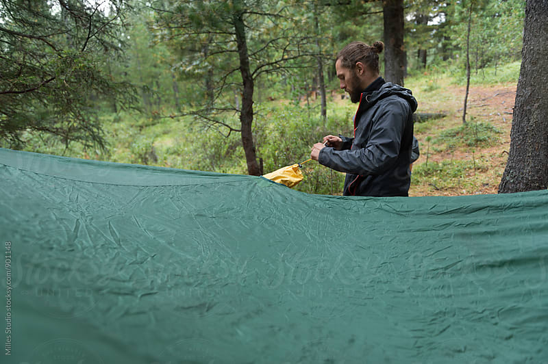 Man pitching the tent by Milles Studio for Stocksy United