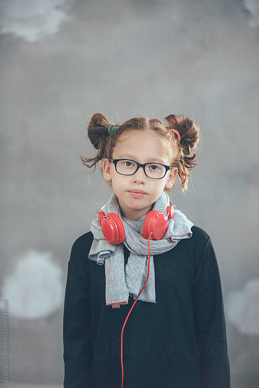Portrait redhead girl with a red headphones by Lydia Cazorla for Stocksy United