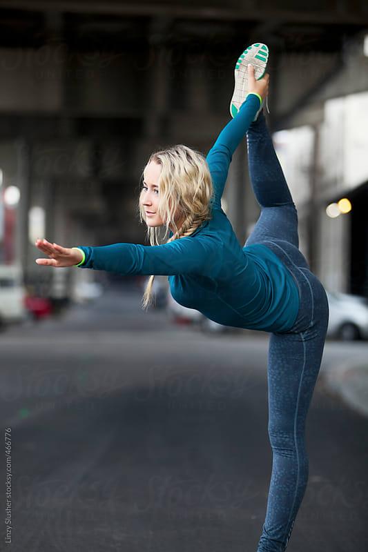 Blonde female model yoga stretching by Linzy Slusher for Stocksy United