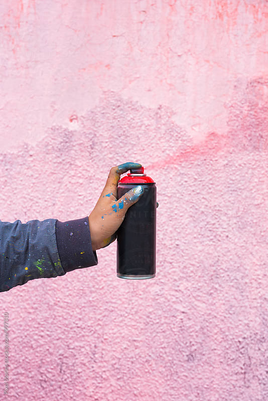 Graffiti artist spraying paint by Pixel Stories for Stocksy United