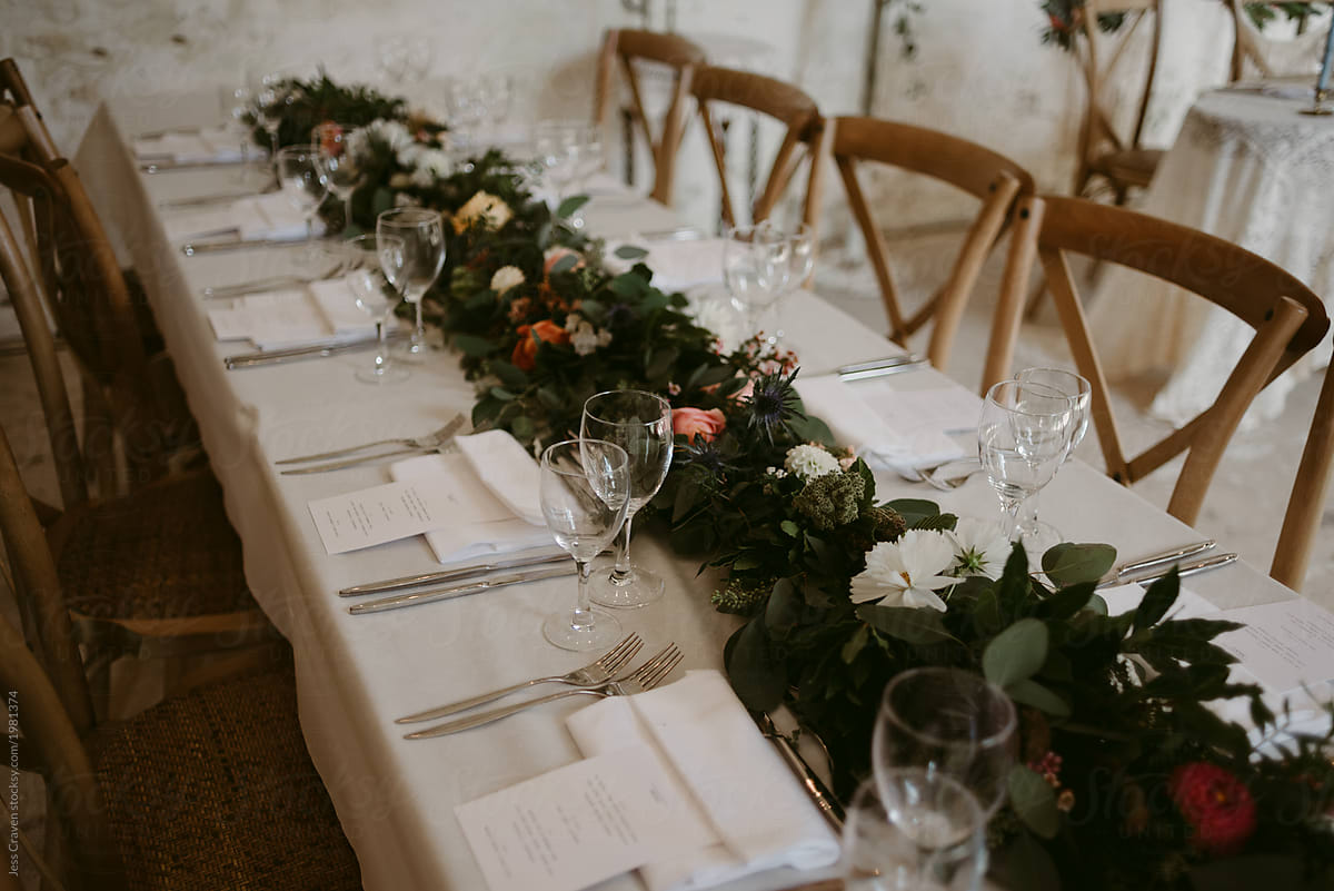 Simple romantic wedding reception table setting by Jess Craven - Stocksy  United