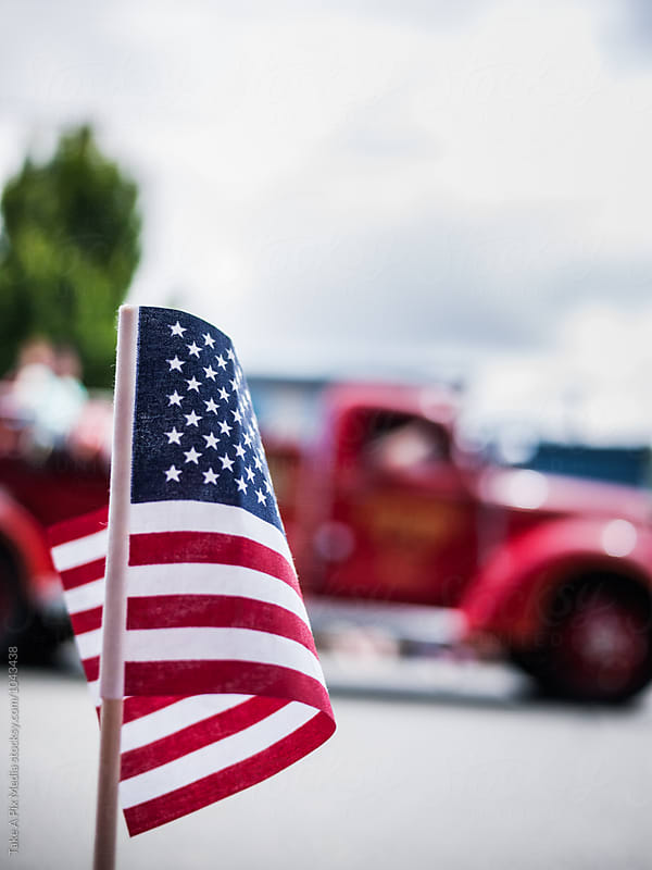 American flag on Fourth of July parade by Suprijono Suharjoto for Stocksy United