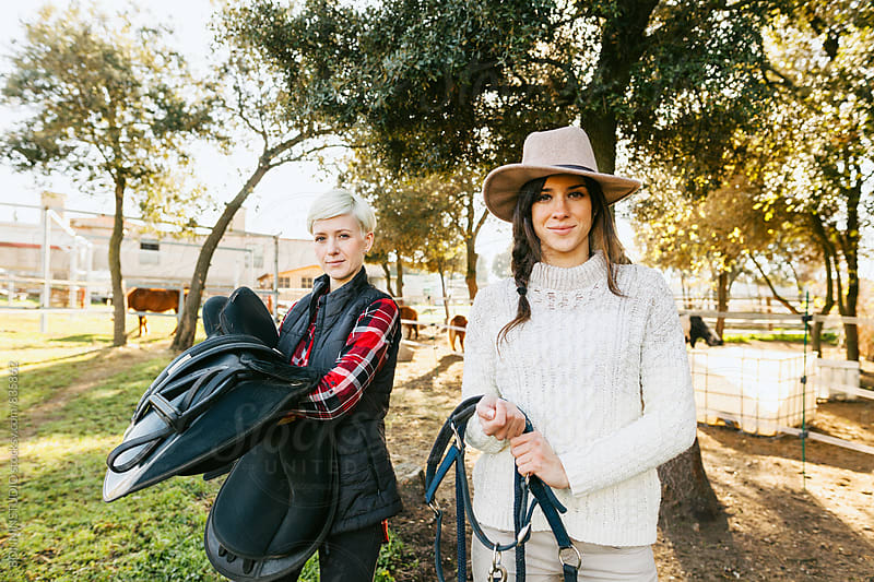 Portrait of horsewomen in a ranch. by BONNINSTUDIO for Stocksy United