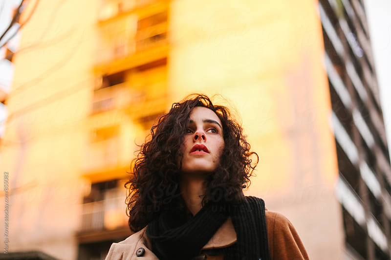 Beautiful curly woman during the sunset  by Marija Kovac for Stocksy United