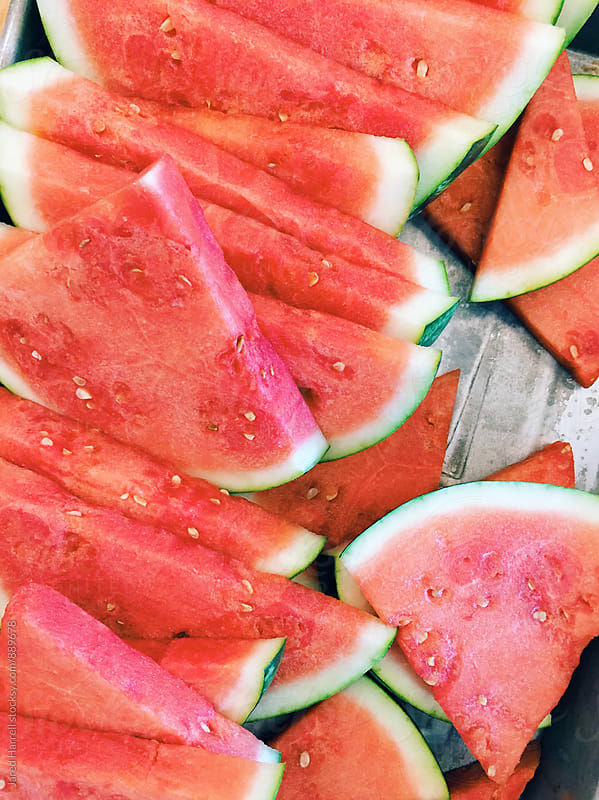 Sliced Watermelon on Picnic Table  by Jared Harrell for Stocksy United