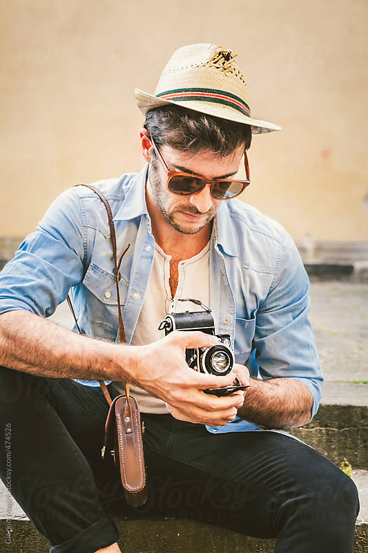 Hipster Man with Retro Camera Sitting on a Staircase by Giorgio Magini for Stocksy United