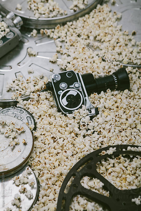 Cinema cameras, reels and popcorn. by kkgas for Stocksy United
