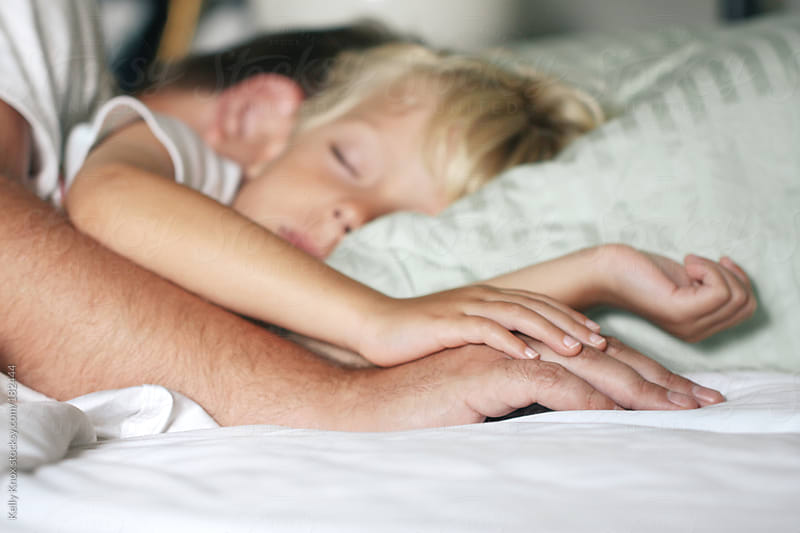 little boy asleep with his father by Kelly Knox for Stocksy United