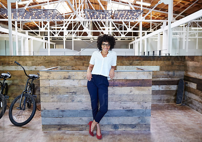 Portrait of millennial businesswoman at office by Trinette Reed for Stocksy United