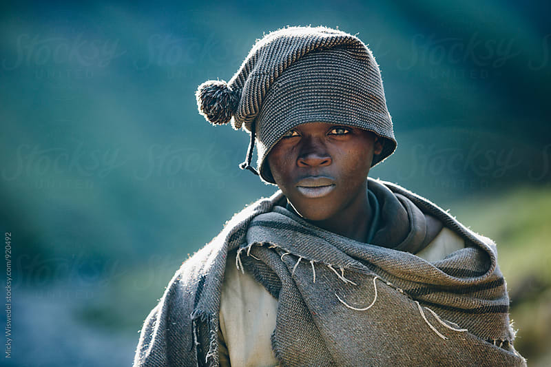 portrait of a rural African Basotho herdsman by Micky Wiswedel for Stocksy United