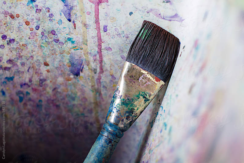 Paint brush in an artist's paint splattered sink by Carolyn Lagattuta for Stocksy United