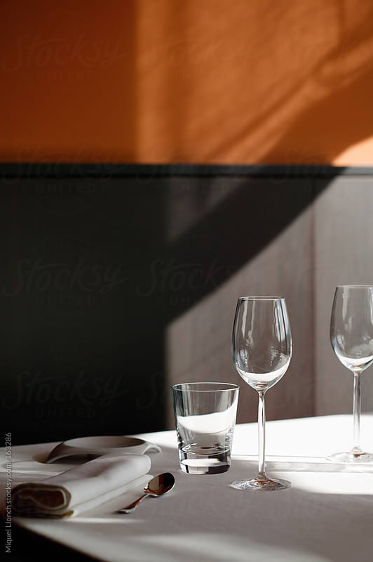 Table setting in a modern restaurant by Miquel Llonch for Stocksy United