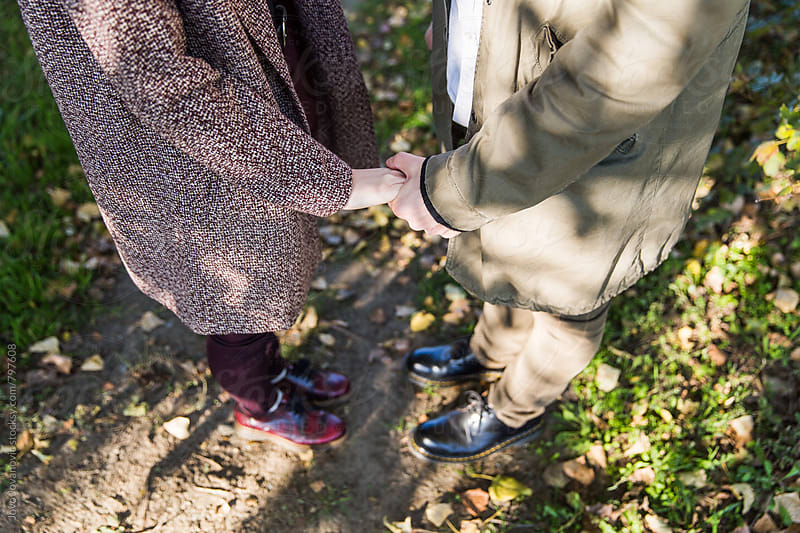 Closeup of a young couple holding hands by Jovo Jovanovic for Stocksy United