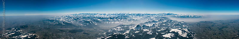 Aerial mountain panorama of swiss alps by Peter Wey for Stocksy United