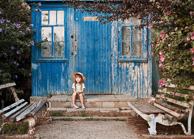 Little girl in a hat by Sveta SH for Stocksy United