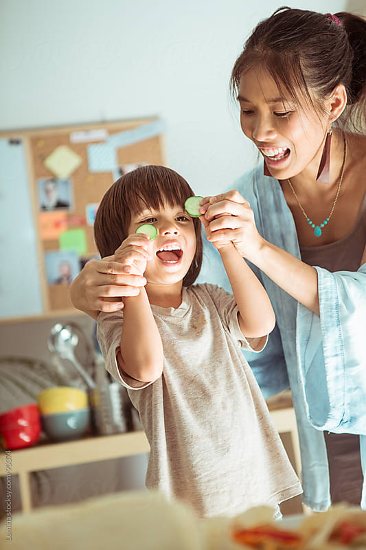 Cooking Together: Mother and Son Having Fun in the Kitchen by Lumina for Stocksy United