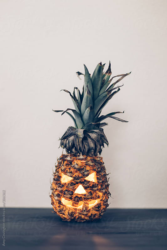 Halloween pineapple-o'-lantern by Amy Covington for Stocksy United