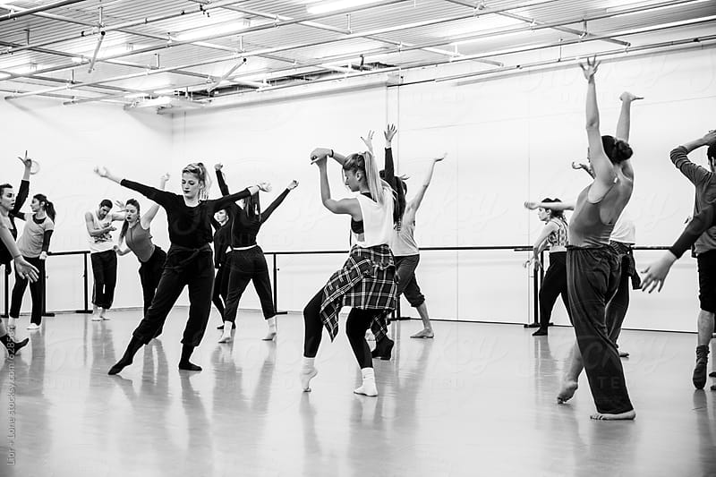 Dancers practicing their routine in studio by Lior + Lone for Stocksy United