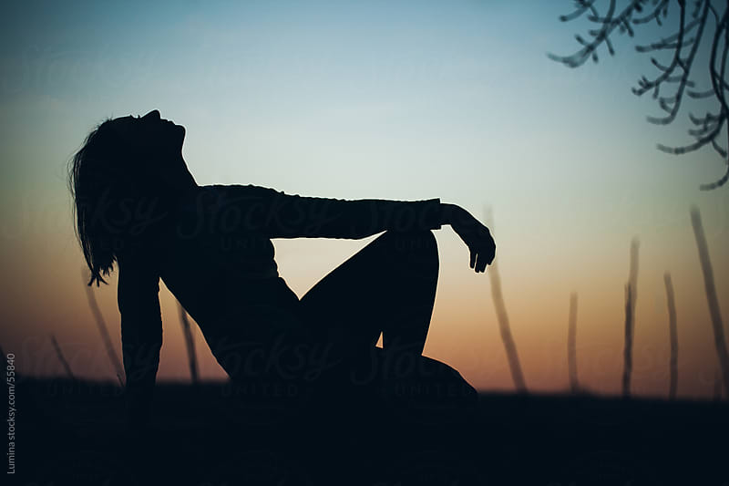 Silhouette of a Woman Sitting in Nature by Lumina for Stocksy United