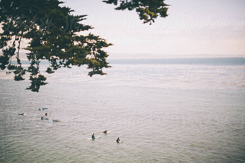 Surfers Waiting by Briana Morrison for Stocksy United