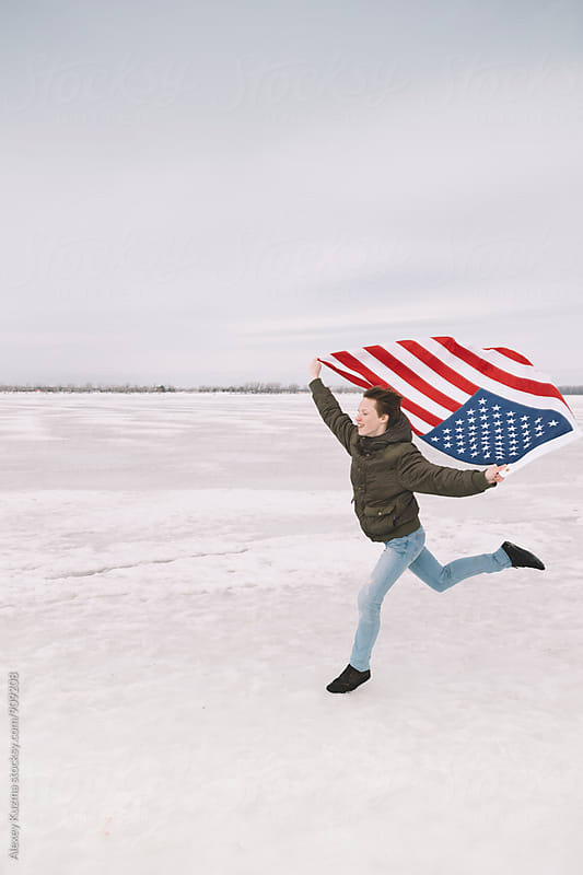 happy young man with USA flag by Alexey Kuzma for Stocksy United