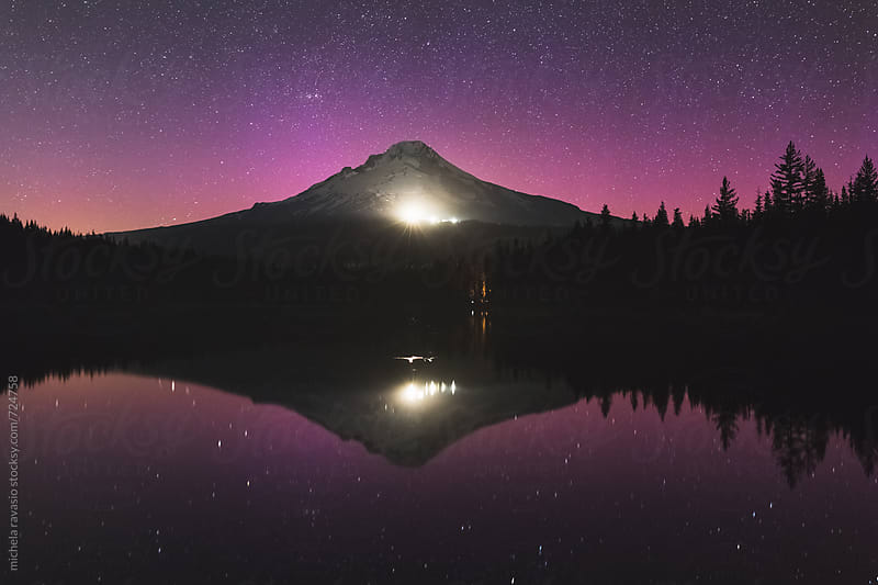 Mt Hood reflected in Trillium Lake in a starry night by michela ravasio for Stocksy United
