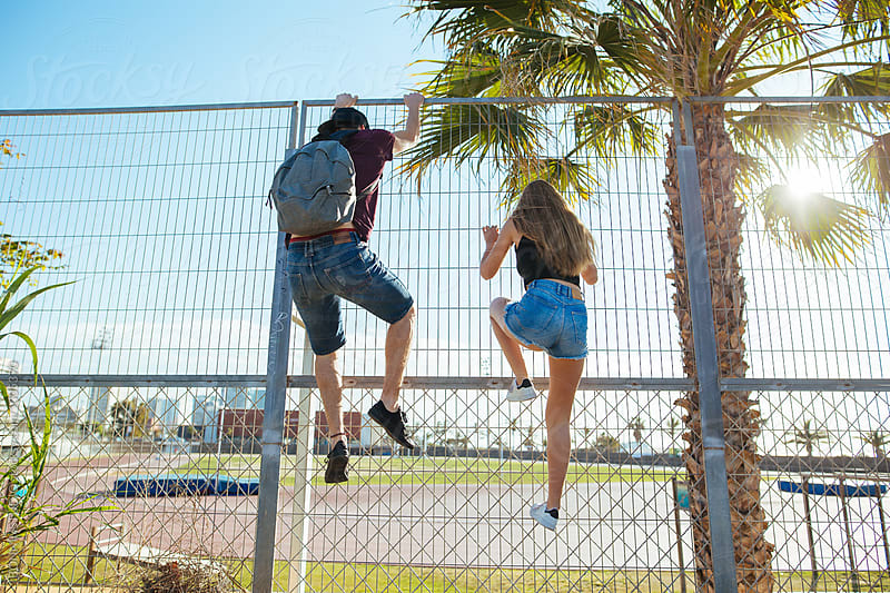 Teenage couple in summer.  by BONNINSTUDIO for Stocksy United