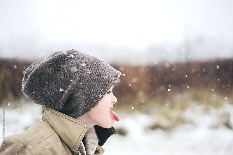 Catching Snowflakes by Melanie DeFazio for Stocksy United