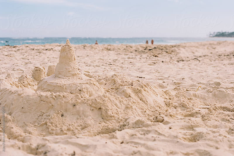 Sand castle on Caribbean beach by Joey Pasco for Stocksy United