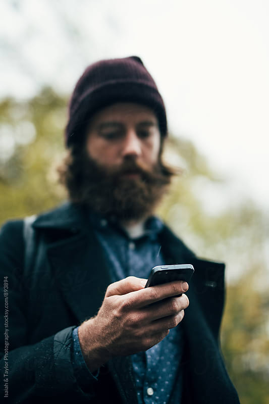 Man using phone by Isaiah & Taylor Photography for Stocksy United