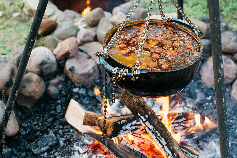 Traditional Gulyas cooking over the fire by Gabriel (Gabi) Bucataru for Stocksy United