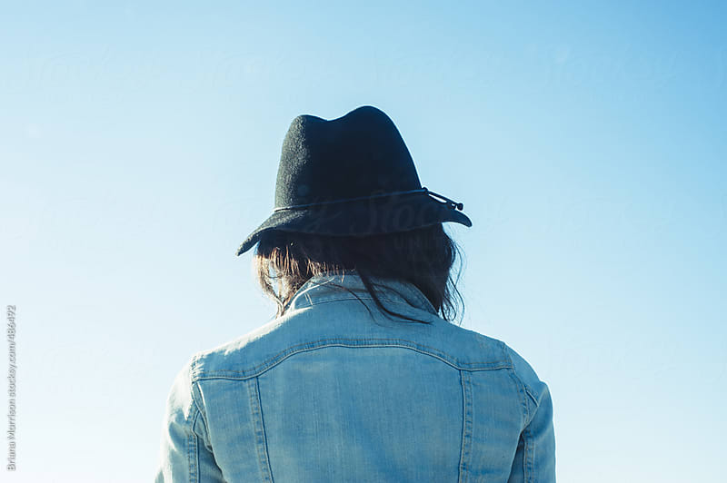 The Back of Her Head and a Blue Sky by Briana Morrison for Stocksy United