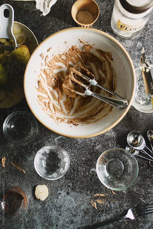 Messy kitchen table after preparing a bake recipe. by Darren Muir for Stocksy United