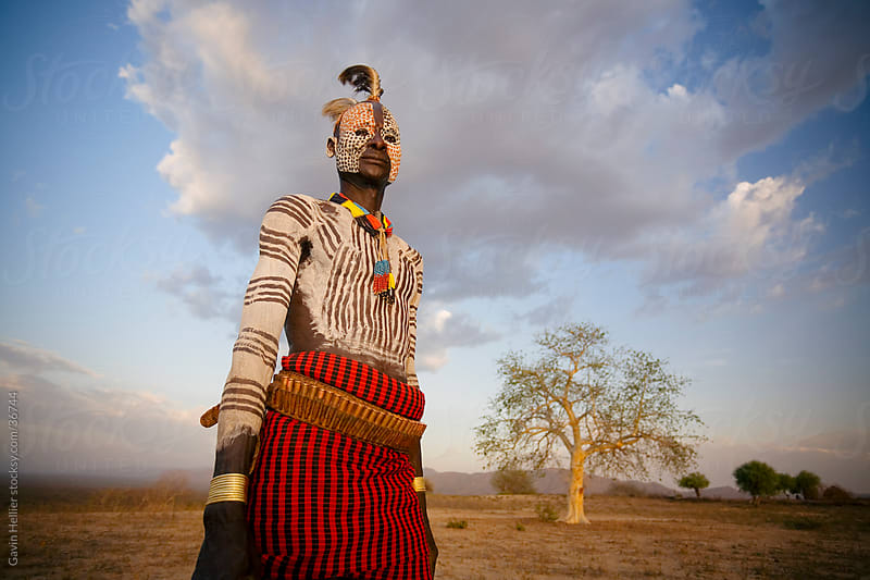 Portrait of a Karo tribesman with facial decoration imitating the spotted plumage of the guinea fowl, Omo River, Lower Omo Valley, Ethiopia, Africa by Gavin Hellier for Stocksy United