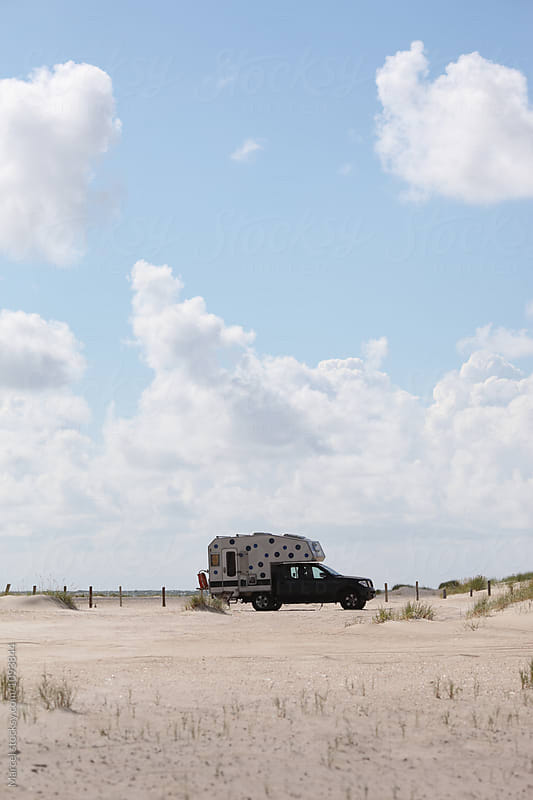Cool camper on the beach by Marcel for Stocksy United