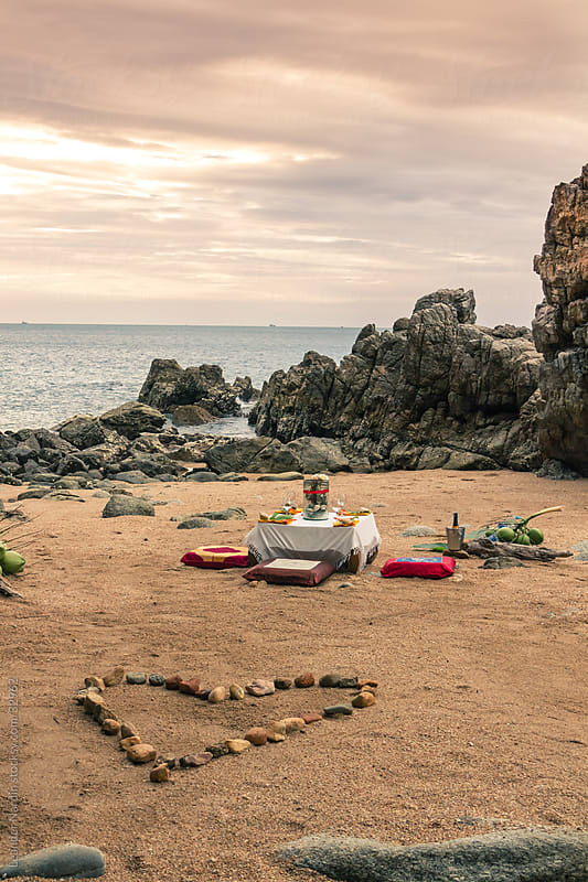 romantic dinner on the beach by Leander Nardin for Stocksy United