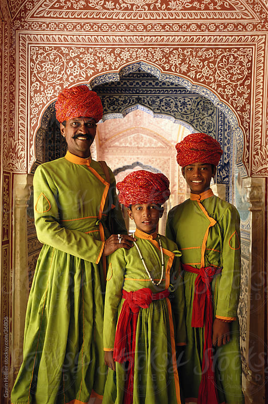 India, Jaipur, Samode Palace, father and sons in hallway, portrait by Gavin Hellier for Stocksy United
