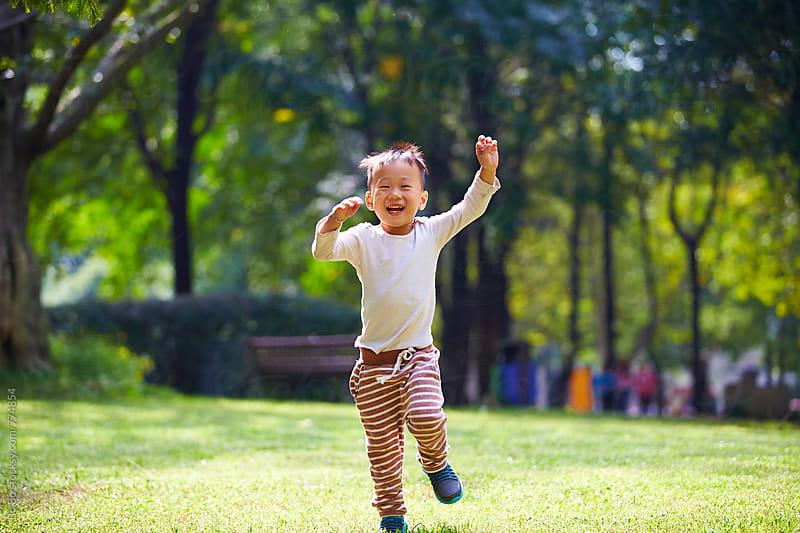 lovely little boy in the sunny autumn park by cuiyan Liu for Stocksy United