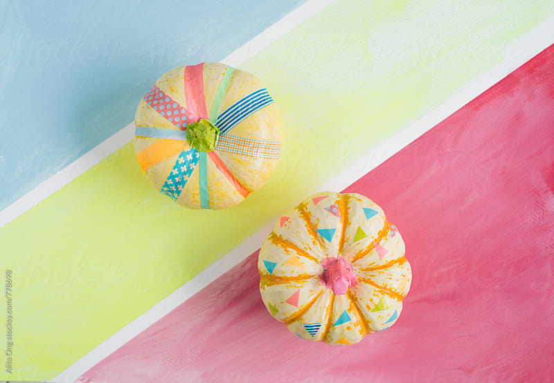 Cute pumpkins decorated with colourful washi tapes by Alita Ong for Stocksy United