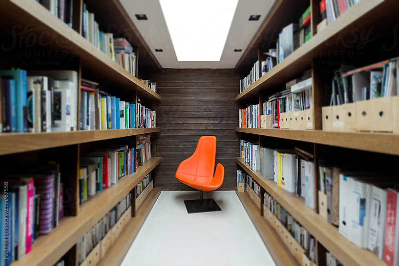 Office library and modern chair by Paul Phillips for Stocksy United
